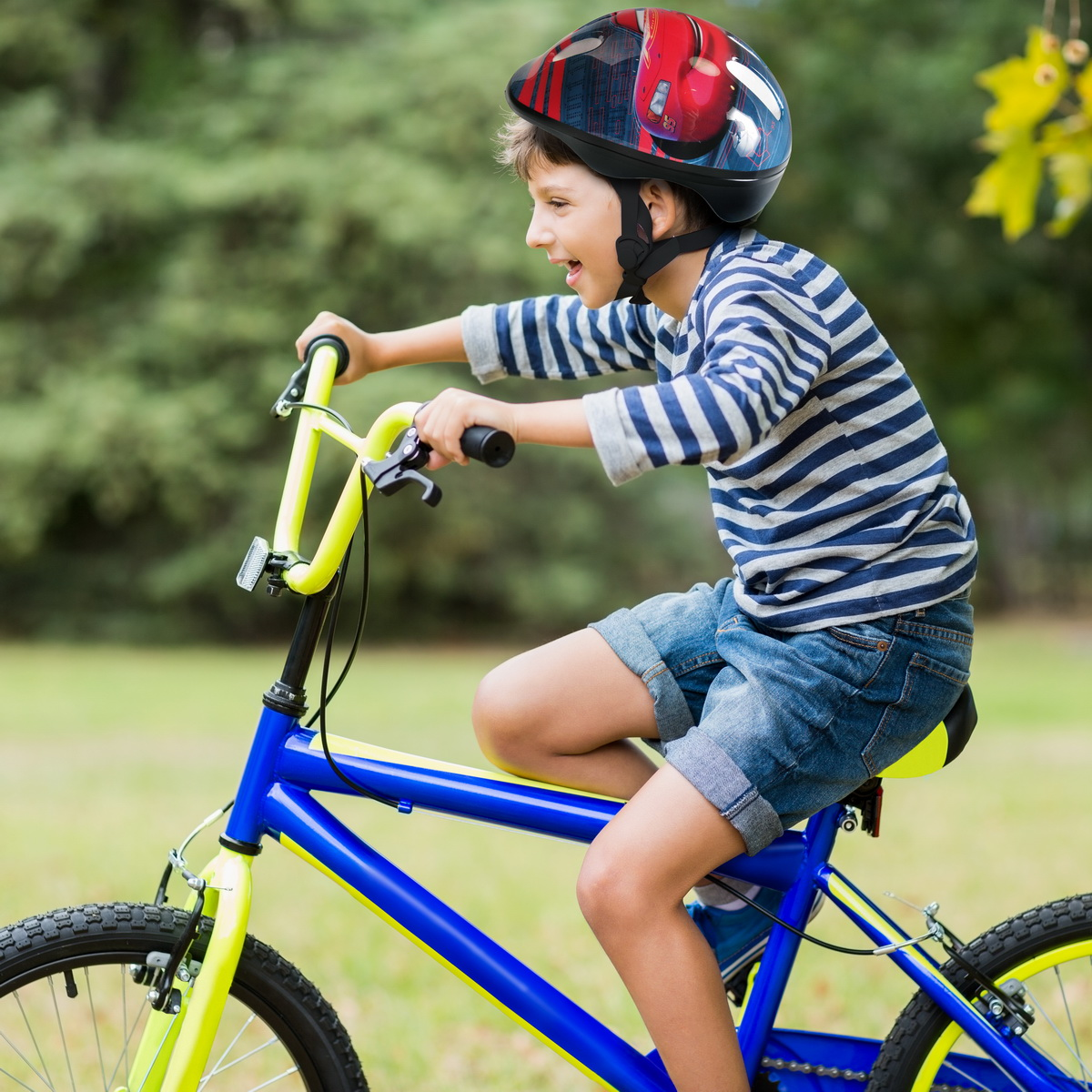 Smiling boy riding a bicycle
