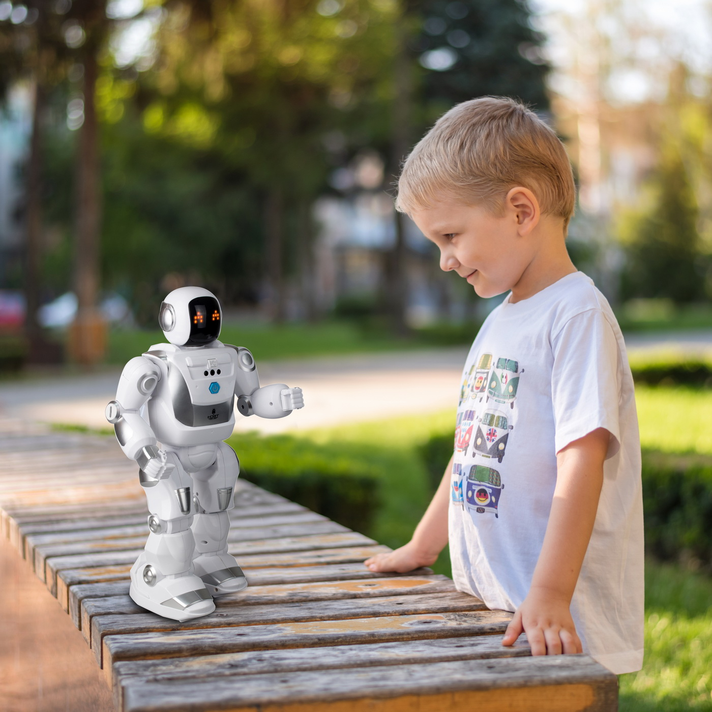 little boy playing outside with a robot
