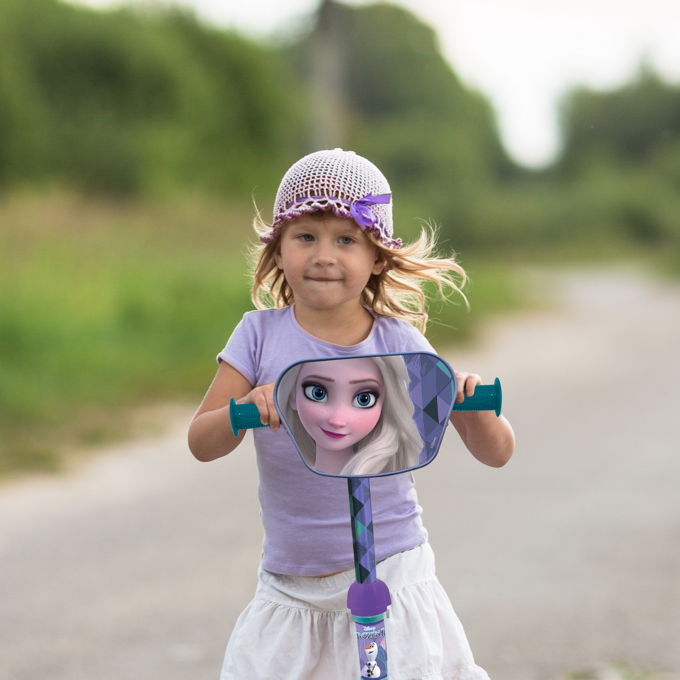 girl child riding  scooter on the road In the countryside, child